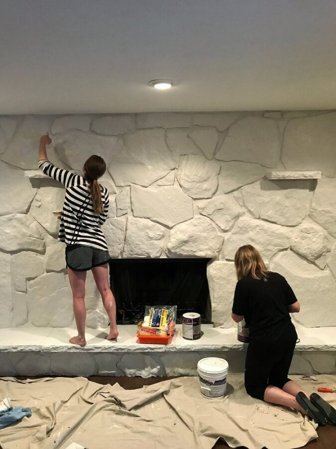 Painting the rock fireplace with my mom.
