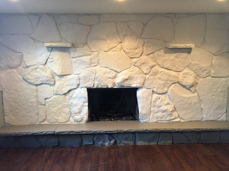 The painted rock fireplace.