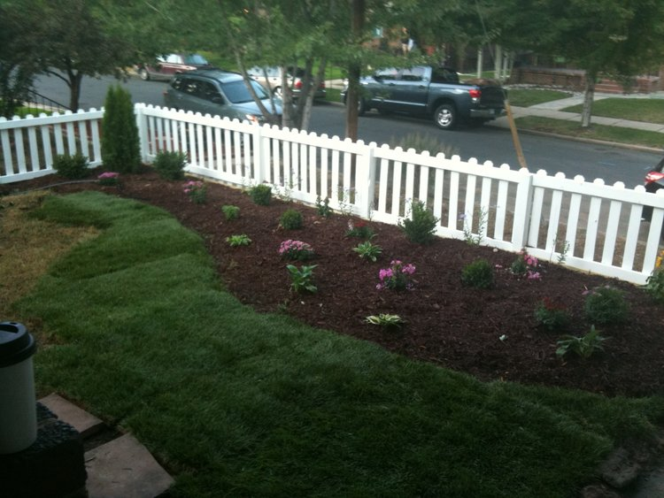 New flower beds and white picket fence