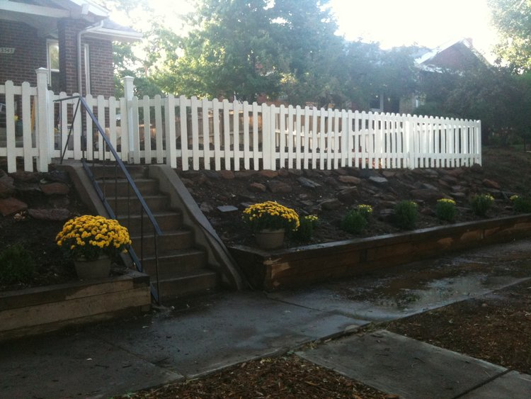 Painted white picket fence