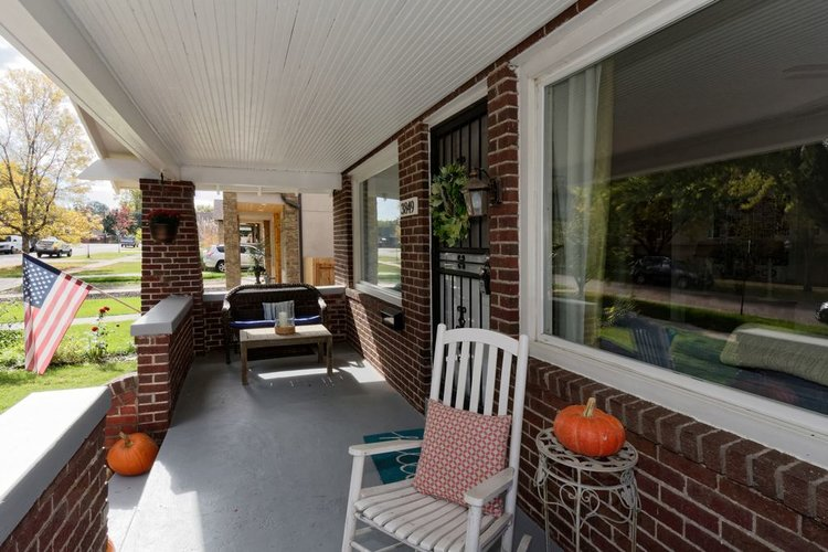 Update your exterior with extra seating on the porch