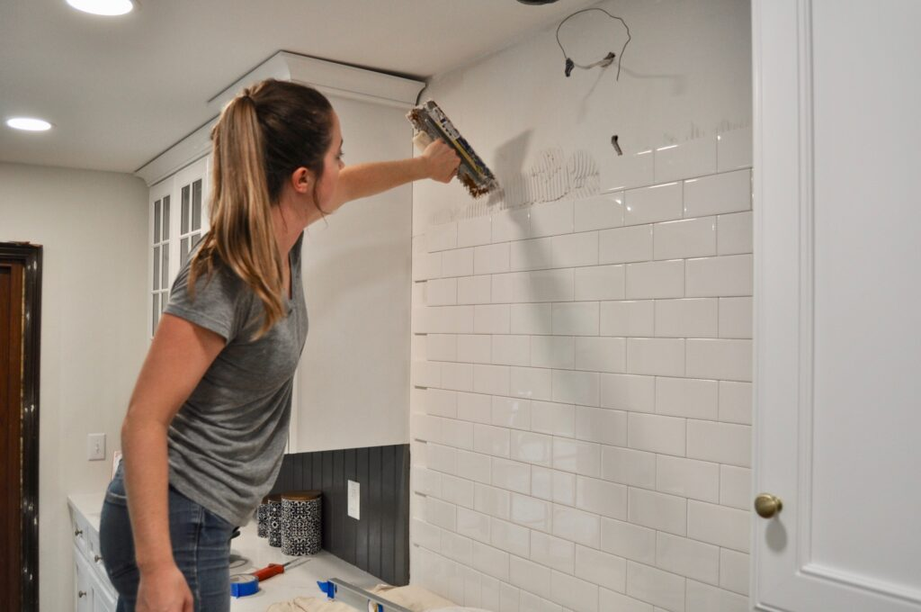 Use your trowel to apply the tile adhesive