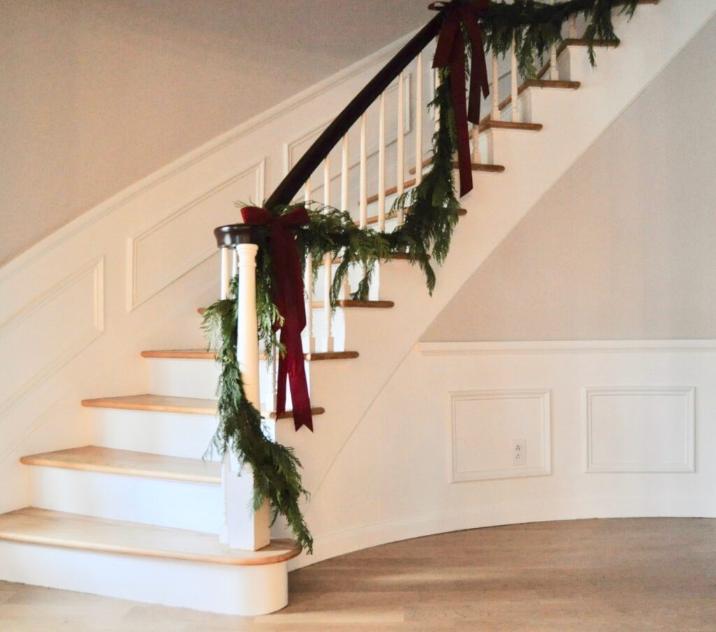Front foyer staircase decorated with Christmas garland